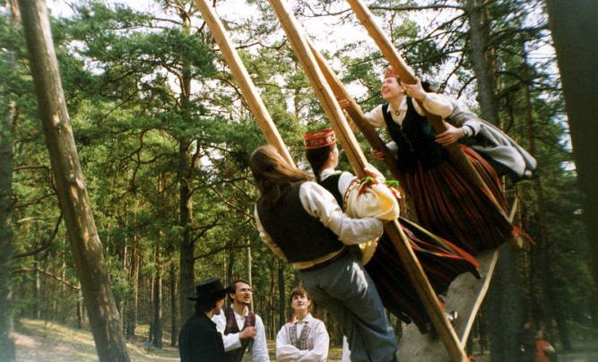 Latvians performing Easter day traditions.