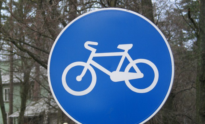 Road sign warning about a bicycle track.