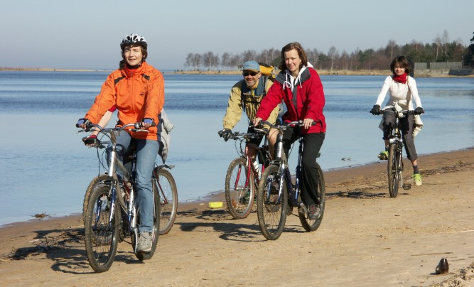 Family cycling by the sea near Riga city.