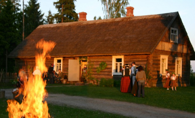 Midsummer night celebration in traditional farmstead.