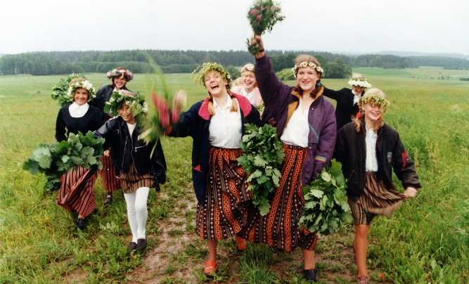 Children singing and picking Jānis day flowers.