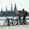 Couple sightseeing Riga by bikes.