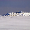 Pile of ice on the sea near cape Kolka in winter.